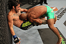 SUNRISE, FL - JUNE 08:   (R-L) Demetrious Johnson takes down Ian McCall in a Flyweight bout during the UFC on FX 3 event at Bank Atlantic Center on June 8, 2012 in Sunrise, Florida.  (Photo by Josh Hedges/Zuffa LLC/Zuffa LLC via Getty Images)