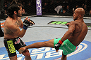 SUNRISE, FL - JUNE 08:   (R-L) Demetrious Johnson kicks Ian McCallin a Flyweight bout during the UFC on FX 3 event at Bank Atlantic Center on June 8, 2012 in Sunrise, Florida.  (Photo by Josh Hedges/Zuffa LLC/Zuffa LLC via Getty Images)