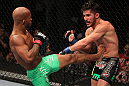 SUNRISE, FL - JUNE 08:   (L-R) Demetrious Johnson kicks Ian McCall in a Flyweight bout during the UFC on FX 3 event at Bank Atlantic Center on June 8, 2012 in Sunrise, Florida.  (Photo by Josh Hedges/Zuffa LLC/Zuffa LLC via Getty Images)