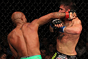 SUNRISE, FL - JUNE 08:   (L-R) Demetrious Johnson punches Ian McCall in a Flyweight bout during the UFC on FX 3 event at Bank Atlantic Center on June 8, 2012 in Sunrise, Florida.  (Photo by Josh Hedges/Zuffa LLC/Zuffa LLC via Getty Images)