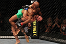 SUNRISE, FL - JUNE 08:   (R-L) Ian McCall suplexes Demetrious Johnson in a Flyweight bout during the UFC on FX 3 event at Bank Atlantic Center on June 8, 2012 in Sunrise, Florida.  (Photo by Josh Hedges/Zuffa LLC/Zuffa LLC via Getty Images)