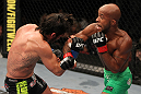 SUNRISE, FL - JUNE 08:   (R-L) Demetrious Johnson punches Ian McCall in a Flyweight bout during the UFC on FX 3 event at Bank Atlantic Center on June 8, 2012 in Sunrise, Florida.  (Photo by Josh Hedges/Zuffa LLC/Zuffa LLC via Getty Images)