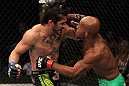 SUNRISE, FL - JUNE 08:   (L-R) Ian McCall and Demetrious Johnson trade punches in a Flyweight bout during the UFC on FX 3 event at Bank Atlantic Center on June 8, 2012 in Sunrise, Florida.  (Photo by Josh Hedges/Zuffa LLC/Zuffa LLC via Getty Images)