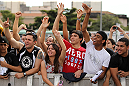 BELO HORIZONTE, BRAZIL - JUNE 20:   Fans cheer during the UFC 147 open workouts at Praca da Estacao on June 20, 2012 in Belo Horizonte, Brazil.  (Photo by Josh Hedges/Zuffa LLC/Zuffa LLC via Getty Images)