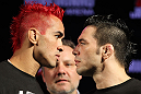 "BELO HORIZONTE, BRAZIL - JUNE 21:   (L-R) Opponents Godofredo Pepey and Rony ""Jason"" Mariano Bezerra face off during the UFC 147 press conference at Ouro Minas Palace on June 21, 2012 in Belo Horizonte, Brazil.  (Photo by Josh Hedges/Zuffa LLC/Zuffa LLC via Getty Images)"