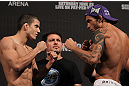 BELO HORIZONTE, BRAZIL - JUNE 22:   (L-R) Opponents Felipe Arantes and Milton Vieira face off after making weight during the UFC 147 weigh in at Estádio Jornalista Felipe Drummond on June 22, 2012 in Belo Horizonte, Brazil.  (Photo by Josh Hedges/Zuffa LLC/Zuffa LLC via Getty Images)