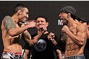 BELO HORIZONTE, BRAZIL - JUNE 22:   (L-R) Opponents Marcos Vinicius and Wagner Campos face off after making weight during the UFC 147 weigh in at Estádio Jornalista Felipe Drummond on June 22, 2012 in Belo Horizonte, Brazil.  (Photo by Josh Hedges/Zuffa LLC/Zuffa LLC via Getty Images)