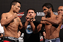 BELO HORIZONTE, BRAZIL - JUNE 22:   (L-R) Opponents John Teixeira and Hugo