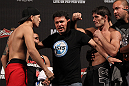 BELO HORIZONTE, BRAZIL - JUNE 22:   (L-R) Opponents Anistavio Medeiros and Rodrigo Damm are separated after facing off during the UFC 147 weigh in at Estadio Jornalista Felipe Drummond on June 22, 2012 in Belo Horizonte, Brazil.  (Photo by Josh Hedges/Zuffa LLC/Zuffa LLC via Getty Images)