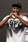 "BELO HORIZONTE, BRAZIL - JUNE 22:   Sergio ""Serginho"" Moraes salutes the crowd before weighing in during the UFC 147 weigh in at Estadio Jornalista Felipe Drummond on June 22, 2012 in Belo Horizonte, Brazil.  (Photo by Josh Hedges/Zuffa LLC/Zuffa LLC via Getty Images)"