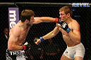 ATLANTIC CITY, NJ - JUNE 22: Dan Miller (L) and Ricardo Funch (R) exchange punches in a welterweight bout during UFC on FX 4 at Revel Casino on June 22, 2012 in Atlantic City, New Jersey. (Photo by Nick Laham/Zuffa LLC/Zuffa LLC)