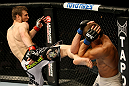 ATLANTIC CITY, NJ - JUNE 22:  Dan Miller (L) kicks Ricardo Funch (R) in a welterweight bout during UFC on FX 4 at Revel Casino on June 22, 2012 in Atlantic City, New Jersey.  (Photo by Nick Laham/Zuffa LLC/Zuffa LLC)