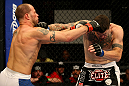 ATLANTIC CITY, NJ - JUNE 22:  Nick Catone (L) and Chris Camozzi (R) exchange punches in a middleweight bout during UFC on FX 4 at Revel Casino on June 22, 2012 in Atlantic City, New Jersey.  (Photo by Nick Laham/Zuffa LLC/Zuffa LLC)
