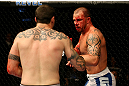 ATLANTIC CITY, NJ - JUNE 22:  Nick Catone (R) battles against Chris Camozzi (L) in a middleweight bout during UFC on FX 4 at Revel Casino on June 22, 2012 in Atlantic City, New Jersey.  (Photo by Nick Laham/Zuffa LLC/Zuffa LLC)