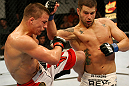 ATLANTIC CITY, NJ - JUNE 22:  Brock Jardine (R) throws a punch against Rick Story (L) who throws a kick in a welterweight bout during UFC on FX 4 at Revel Casino on June 22, 2012 in Atlantic City, New Jersey.  (Photo by Nick Laham/Zuffa LLC/Zuffa LLC)