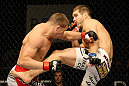 ATLANTIC CITY, NJ - JUNE 22:  Brock Jardine (R) kicks Rick Story (L) who hits him with a punch in a welterweight bout during UFC on FX 4 at Revel Casino on June 22, 2012 in Atlantic City, New Jersey.  (Photo by Nick Laham/Zuffa LLC/Zuffa LLC)