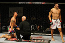 ATLANTIC CITY, NJ - JUNE 22:  Ramsey Nijem (R) celebrates his TKO win over C.J. Keith (L) who is tended to by referee Yves Lavigne (C) in a lightweight bout during UFC on FX 4 at Revel Casino on June 22, 2012 in Atlantic City, New Jersey.  (Photo by Nick Laham/Zuffa LLC/Zuffa LLC)