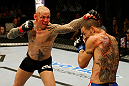 ATLANTIC CITY, NJ - JUNE 22: Ross Pearson (L) punches Cub Swanson (R) in a featherweight bout during UFC on FX 4 at Revel Casino on June 22, 2012 in Atlantic City, New Jersey.  (Photo by Nick Laham/Zuffa LLC/Zuffa LLC)