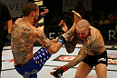 ATLANTIC CITY, NJ - JUNE 22: Cub Swanson (L) kicks Ross Pearson (R) in a featherweight bout during UFC on FX 4 at Revel Casino on June 22, 2012 in Atlantic City, New Jersey.  (Photo by Nick Laham/Zuffa LLC/Zuffa LLC)