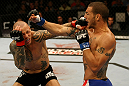 ATLANTIC CITY, NJ - JUNE 22: Cub Swanson (R) exchanges punches with Ross Pearson (L) in a featherweight bout during UFC on FX 4 at Revel Casino on June 22, 2012 in Atlantic City, New Jersey. (Photo by Nick Laham/Zuffa LLC/Zuffa LLC)
