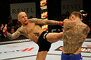 ATLANTIC CITY, NJ - JUNE 22:  Ross Pearson (L) kicks Cub Swanson (R) in a featherweight bout during UFC on FX 4 at Revel Casino on June 22, 2012 in Atlantic City, New Jersey.  (Photo by Nick Laham/Zuffa LLC/Zuffa LLC)