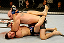 ATLANTIC CITY, NJ - JUNE 22:  Brian Ebersole (T) puts an elbow to the face of T.J. Waldburger (B) while grappling in a welterweight bout during UFC on FX 4 at Revel Casino on June 22, 2012 in Atlantic City, New Jersey.  (Photo by Nick Laham/Zuffa LLC/Zuffa LLC)