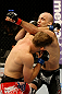 ATLANTIC CITY, NJ - JUNE 22:  Brian Ebersole (R) exchanges punches with T.J. Waldburger (L) in a welterweight bout during UFC on FX 4 at Revel Casino on June 22, 2012 in Atlantic City, New Jersey.  (Photo by Nick Laham/Zuffa LLC/Zuffa LLC)