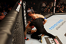 ATLANTIC CITY, NJ - JUNE 22:  Referee Yves Lavigne (C) ends the fight between Ross Pearson (L) and Cub Swanson (R) in a featherweight bout during UFC on FX 4 at Revel Casino on June 22, 2012 in Atlantic City, New Jersey.  (Photo by Nick Laham/Zuffa LLC/Zuffa LLC)