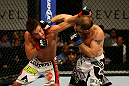 ATLANTIC CITY, NJ - JUNE 22: Sam Stout (L) exchanges punches with Spencer Fisher (R) in a lightweight bout during UFC on FX 4 at Revel Casino on June 22, 2012 in Atlantic City, New Jersey. (Photo by Nick Laham/Zuffa LLC/Zuffa LLC)