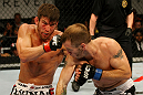 ATLANTIC CITY, NJ - JUNE 22:  Sam Stout (L) punches Spencer Fisher (R) in a lightweight bout during UFC on FX 4 at Revel Casino on June 22, 2012 in Atlantic City, New Jersey.  (Photo by Nick Laham/Zuffa LLC/Zuffa LLC)