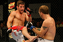 ATLANTIC CITY, NJ - JUNE 22: Sam Stout (L) kicks Spencer Fisher (R) in a lightweight bout during UFC on FX 4 at Revel Casino on June 22, 2012 in Atlantic City, New Jersey.  (Photo by Nick Laham/Zuffa LLC/Zuffa LLC)