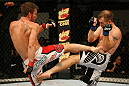 ATLANTIC CITY, NJ - JUNE 22: Sam Stout (L) exchanges kicks with Spencer Fisher (R) in a lightweight bout during UFC on FX 4 at Revel Casino on June 22, 2012 in Atlantic City, New Jersey. (Photo by Nick Laham/Zuffa LLC/Zuffa LLC)