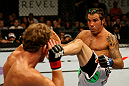 ATLANTIC CITY, NJ - JUNE 22:  Clay Guida (R) kicks Gray Maynard (L) in the main event lightweight bout during UFC on FX 4 at Revel Casino on June 22, 2012 in Atlantic City, New Jersey.  (Photo by Nick Laham/Zuffa LLC/Zuffa LLC)