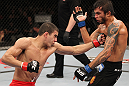 BELO HORIZONTE, BRAZIL - JUNE 23:   (L-R) Felipe Arantes delivers a punch to the body of Milton Vieira during their UFC 147 featherweight bout at Estadio Jornalista Felipe Drummond on June 23, 2012 in Belo Horizonte, Brazil.  (Photo by Josh Hedges/Zuffa LLC/Zuffa LLC via Getty Images)