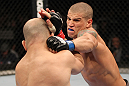 BELO HORIZONTE, BRAZIL - JUNE 23:   (R-L) Leonardo Mafra punches Thiago Perpetuo during their UFC 147 middleweight bout at Estadio Jornalista Felipe Drummond on June 23, 2012 in Belo Horizonte, Brazil.  (Photo by Josh Hedges/Zuffa LLC/Zuffa LLC via Getty Images)