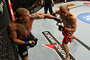 "BELO HORIZONTE, BRAZIL - JUNE 23:   (L-R) Leonardo Mafra punches Thiago ""Bodao"" Perpetuo during their UFC 147 middleweight bout at Estadio Jornalista Felipe Drummond on June 23, 2012 in Belo Horizonte, Brazil.  (Photo by Josh Hedges/Zuffa LLC/Zuffa LLC via Getty Images)"