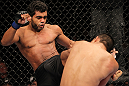 "BELO HORIZONTE, BRAZIL - JUNE 23:   (L-R) Hugo ""Wolverine"" Viana kicks John Teixeira during their UFC 147 featherweight bout at Estadio Jornalista Felipe Drummond on June 23, 2012 in Belo Horizonte, Brazil.  (Photo by Josh Hedges/Zuffa LLC/Zuffa LLC via Getty Images)"