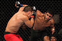 "BELO HORIZONTE, BRAZIL - JUNE 23:   (R-L) Hugo ""Wolverine"" Viana punches John Teixeira during their UFC 147 featherweight bout at Estadio Jornalista Felipe Drummond on June 23, 2012 in Belo Horizonte, Brazil.  (Photo by Josh Hedges/Zuffa LLC/Zuffa LLC via Getty Images)"