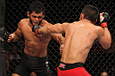 "BELO HORIZONTE, BRAZIL - JUNE 23:   (R-L) John Teixeira punches Hugo ""Wolverine"" Viana during their UFC 147 featherweight bout at Estadio Jornalista Felipe Drummond on June 23, 2012 in Belo Horizonte, Brazil.  (Photo by Josh Hedges/Zuffa LLC/Zuffa LLC via Getty Images)"