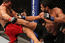 "BELO HORIZONTE, BRAZIL - JUNE 23:   (R-L) Hugo ""Wolverine"" Viana kicks John Teixeira during their UFC 147 featherweight bout at Estadio Jornalista Felipe Drummond on June 23, 2012 in Belo Horizonte, Brazil.  (Photo by Josh Hedges/Zuffa LLC/Zuffa LLC via Getty Images)"