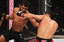 "BELO HORIZONTE, BRAZIL - JUNE 23:   (L-R) Hugo ""Wolverine"" Viana punches John Teixeira during their UFC 147 featherweight bout at Estadio Jornalista Felipe Drummond on June 23, 2012 in Belo Horizonte, Brazil.  (Photo by Josh Hedges/Zuffa LLC/Zuffa LLC via Getty Images)"