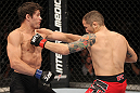"BELO HORIZONTE, BRAZIL - JUNE 23:   (L-R) Rodrigo Damm lands a left that drops Anistavio ""Gasparzinho"" Medeiros during their UFC 147 featherweight bout at Estadio Jornalista Felipe Drummond on June 23, 2012 in Belo Horizonte, Brazil.  (Photo by Josh Hedges/Zuffa LLC/Zuffa LLC via Getty Images)"