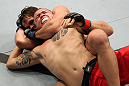 BELO HORIZONTE, BRAZIL - JUNE 23:   (L-R) Rodrigo Damm secures a rear choke submission to defeat Anistavio &quot;Gasparzinho&quot; Medeiros during their UFC 147 featherweight bout at Estadio Jornalista Felipe Drummond on June 23, 2012 in Belo Horizonte, Brazil.  (Photo by Josh Hedges/Zuffa LLC/Zuffa LLC via Getty Images)