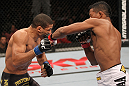 BELO HORIZONTE, BRAZIL - JUNE 23:   (R-L) Yuri Alcantara punches Hacran Dias during their UFC 147 featherweight bout at Estadio Jornalista Felipe Drummond on June 23, 2012 in Belo Horizonte, Brazil.  (Photo by Josh Hedges/Zuffa LLC/Zuffa LLC via Getty Images)