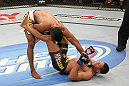 BELO HORIZONTE, BRAZIL - JUNE 23:   (L-R) Yuri Alcantara punches Hacran Dias during their UFC 147 featherweight bout at Estadio Jornalista Felipe Drummond on June 23, 2012 in Belo Horizonte, Brazil.  (Photo by Josh Hedges/Zuffa LLC/Zuffa LLC via Getty Images)