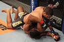 BELO HORIZONTE, BRAZIL - JUNE 23:   Hacran Dias (top) delivers an elbow against Yuri Alcantara during their UFC 147 featherweight bout at Estadio Jornalista Felipe Drummond on June 23, 2012 in Belo Horizonte, Brazil.  (Photo by Josh Hedges/Zuffa LLC/Zuffa LLC via Getty Images)