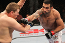 BELO HORIZONTE, BRAZIL - JUNE 23:   (R-L) Fabricio Werdum punches Mike Russow during their UFC 147 heavyweight bout at Estadio Jornalista Felipe Drummond on June 23, 2012 in Belo Horizonte, Brazil.  (Photo by Josh Hedges/Zuffa LLC/Zuffa LLC via Getty Images)