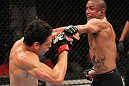"BELO HORIZONTE, BRAZIL - JUNE 23:   (R-L) Sergio ""Serginho"" Moraes punches Cezar ""Mutante"" Ferreira during their UFC 147 middleweight bout at Estadio Jornalista Felipe Drummond on June 23, 2012 in Belo Horizonte, Brazil.  (Photo by Josh Hedges/Zuffa LLC/Zuffa LLC via Getty Images)"