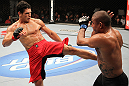 BELO HORIZONTE, BRAZIL - JUNE 23: (L-R) Cezar Ferreira kicks Sergio Moraes during their UFC 147 middleweight bout at Estádio Jornalista Felipe Drummond on June 23, 2012 in Belo Horizonte, Brazil. (Photo by Josh Hedges/Zuffa LLC/Zuffa LLC via Getty Images)