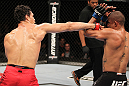 "BELO HORIZONTE, BRAZIL - JUNE 23:   (L-R) Cezar ""Mutante"" Ferreira punches Sergio ""Serginho"" Moraes during their UFC 147 middleweight bout at Estadio Jornalista Felipe Drummond on June 23, 2012 in Belo Horizonte, Brazil.  (Photo by Josh Hedges/Zuffa LLC/Zuffa LLC via Getty Images)"